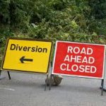 Road ahead closed and diversion signs