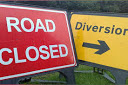 Picture of a road closed sign and a diversion sign